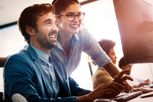 Photographie Happy business people having fun and chatting at workplace office