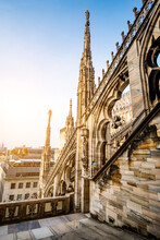 Roof Terraces Of The Famous Duomo Cathedral Of Milan