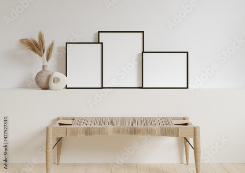 Three 8x10 Vertical and Horizontal Black Frame mockup with decorations on white wall. 3D Rendering