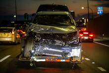 Loaded Broken Car On A Tow Truck After Crash