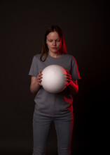 Psychological Concept. Young Woman Looking At White Sphere Or Ball And Thinking, Making Decisions