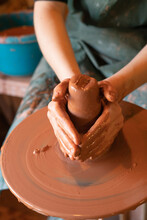 Potter's Hands. Making Clay Products On A Potter's Wheel. Pottery Master Class.