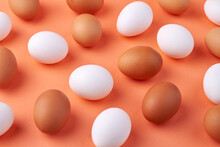 Group Of White And Brown Raw Chicken Eggs.