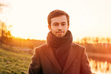 Close-up Young Male Brown Hair And Beard Wearing Brown Coat And
