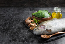 Set Of Food With Fats And Omega-3 On Dark Background