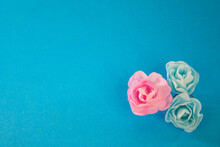 Pink Rose With Blue Roses On Blue Background