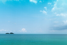 Light Waves On The Turquoise Sea And Distant Islands. For Seascape Background.