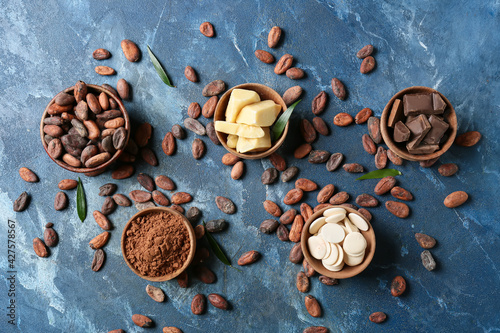 Composition with cocoa beans and chocolate on color background