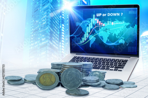 Canvas Print Double exposure of thai baht money , graph up or down and rows of coins for thai