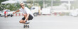 Leinwandbild Motiv asian young man wear sunglasses playing skateboard on street city.
