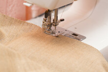 A Sewing Machine And A Piece Of Fabric. Close-up Photo. Shallow Depth Of Field.
