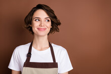 Photo Of Charming Satisfied Person Smile Look Interested Empty Space Isolated On Brown Color Background