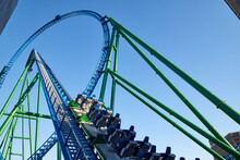 Roller Coaster Ride Against Blue Sky In A Nice Day.