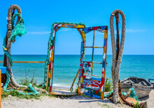 Landscape Photo Of Colorful Instalation On The Beach, Colored Ropes And A Door Leading Towards The Black Sea During A Sunny Summer Day With Blue Sky And Water Waves At Vama Veche, Romania