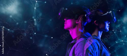 Fotografie, Obraz Teenager having fun play VR virtual reality glasses sport game 3D cyber space fu