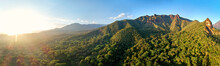 Aerial, Large Panoramic View On Green Slopes Of Bale Mountains Covered In Montane Forest. Harenna Forest, Ethiopia, Africa. Setting Sun Over Bale Mountains National Park. African Nature