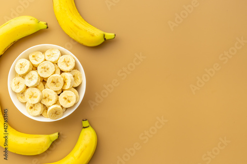Fototapeta Many banana slices with whole bananas. Top view obraz