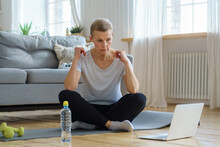 Senior Woman Online Training In Living Room. Mature Female Exercising With Laptop Watching Fitness Tutorials For Sport Relief. Yoga For Emotional And Spiritual Health. Well-being, Wellness On Retired