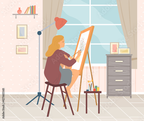 Fotografija Girl sits and paints on canvas with brush