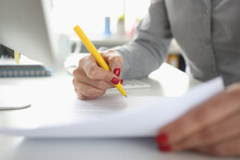 Woman Hand Holds Pen And Signs Document