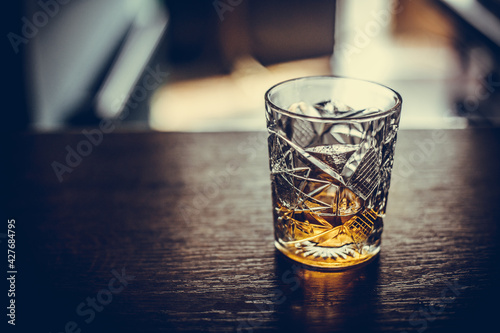 Stampa su Tela Whisky glass on a wooden surface
