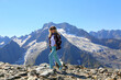 Woman traveller feeling happy at the top of mountain. Freedom lifestyle.