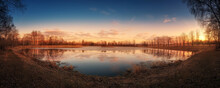Frozen Pond With An Island In The Middle At Sunset, Golden Hour