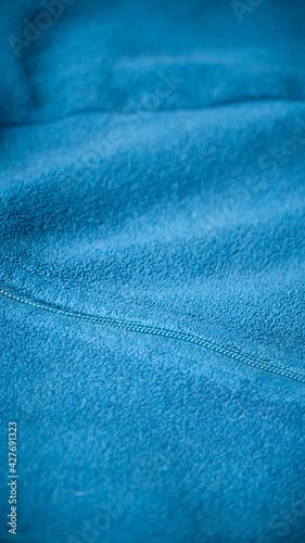 Fotografiet Costura en forro polar azul
