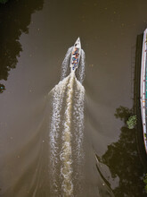 An Aerial View Of A Fisherman Boat Going Out Fishing