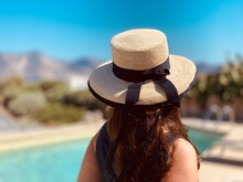 Rear View Of Woman Wearing Hat In Standing Outdoors
