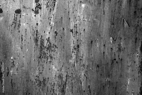 Photo Metal texture with scratches and cracks which can be used as a background
