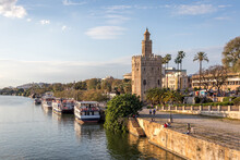 View Of The Guadalquivir River And The Torre Del Oro In Seville Spain. Typical Postcard Of The City.