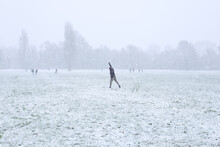 Throwing A Snowball In A Field