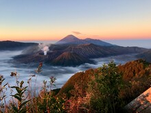Scenic View Of Mountain Against Sky During Sunrise
