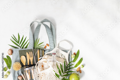 Plastic free set with cotton bags, glass jars and bamboo cutlery top view. Zero waste, eco friendly concept. Flat lay, copy space