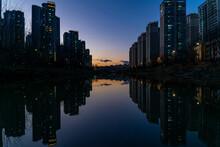 Evening Twilight On The Riverside City