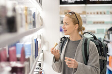 Smiling Woman Standing At Store