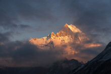 Low Angle View Of Snowcapped Mountains Against Sky During Sunset