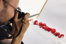 Close-up Of Man Photographing Baubles