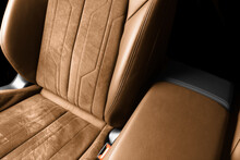 Modern Luxury Car Brown Leather With Alcantara Interior. Part Of Orange Leather Car Seat Details With White Stitching. Interior Of Prestige Car. Perforated Leather Seats Isolated. Perforated Leather.