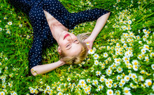 Above View At Blonde Woman In Black Dress Lying In Countryside Chamomiles Flowers Meadow