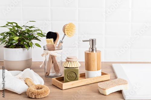 Fototapeta Home cleaning non toxic, natural products. Washing dishen in kitchen with olive oil soap and brushes. Plastic free, zero waste, sustainable lifestyle idea obraz na płótnie