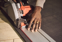 Cropped Hand Of Carpenter Working At Workshop