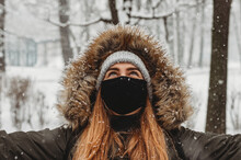 Portrait Of Young Woman Covered With Snow