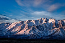 Early Morning Blue Sky With White Clouds Above Snowy Eastern Sierra Nevada Mountains