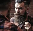 Leinwandbild Motiv Man hipster cutting beard. Barber scissors and straight razor, barber shop, suit. Vintage barber shop, shaving. Portrait bearded man. Vintage barbershop.