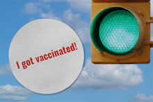 Photo Collage Of A I Got Vaccinated Sticker And A Green Traffic Light Against A Sky, Representing Activities Opening Being Allowed As More People Get Vaccinated