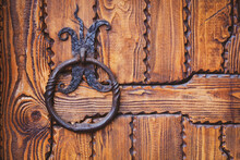 Iron Knocker Or Ring Handle On Old Wooden Door