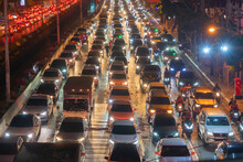 Crowd Of Busy Cars With Heavy Traffic Jam In Rush Hour On Highway Road Street On Bridge In Bangkok Downtown,urban City In Asia, Thailand. Intersection. Toll Gate In Sathorn.Driving Congestion At Night