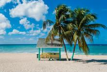 Cabana And Oconut Palm Trees On A Caribbean Beach